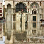Basilica di San Marco reflected in tidal waters