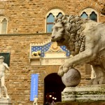 David replica and a lion statue in the Piazza della Signoria