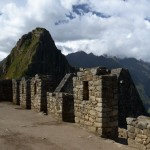 Machu Picchu Ruins with Huayna Picchu Mountain in the distance
